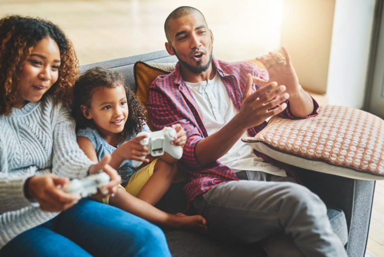Family playing video game together.