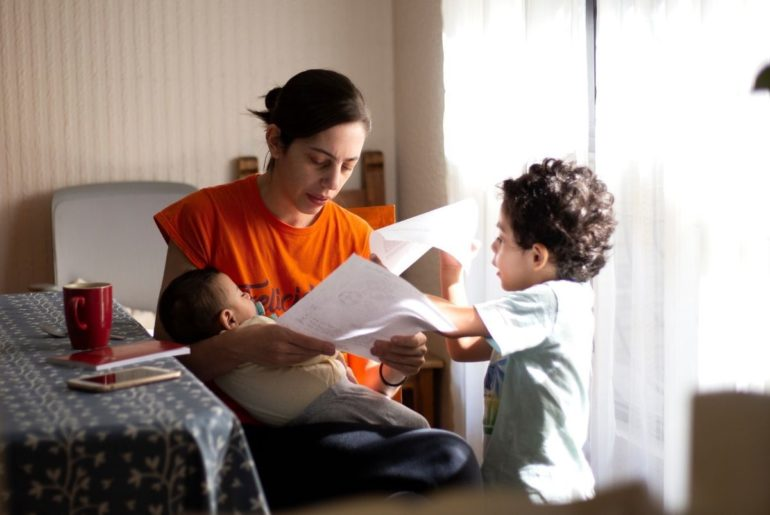 Mom at home with kids applying for a job.