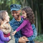 Military family smiling together.