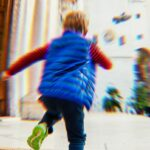 Child blurred because they're running.