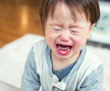 Upset toddler crying.