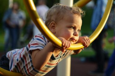 Young boy alone on playground.