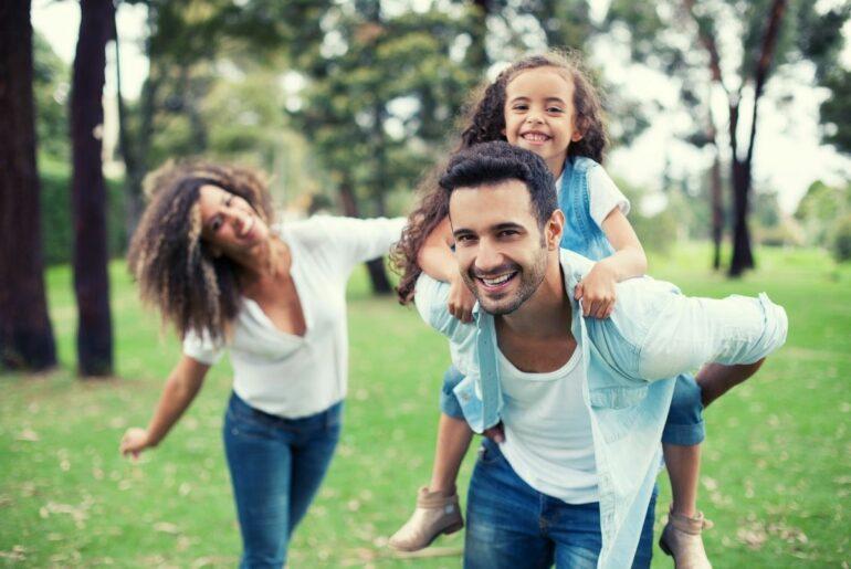 Happy family outdoors.