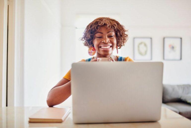 Happy woman at laptop.